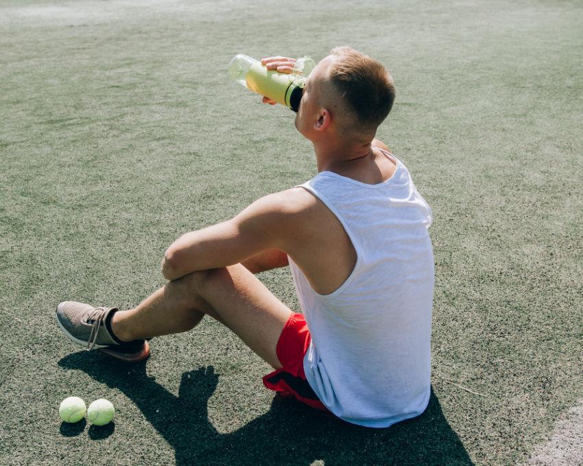 athlete drinking electrolytes