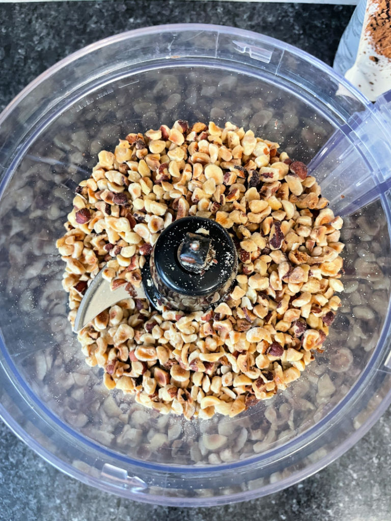 chopped hazelnuts in a food processor for Keto Nutella Spread