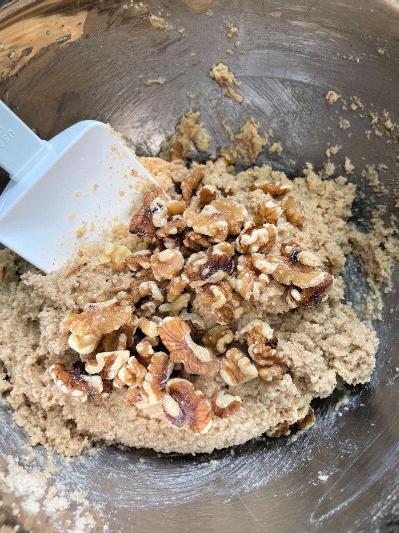 mixing walnuts into Keto Banana Bread