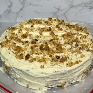 Gluten Free Carrot Cake topped with walnuts