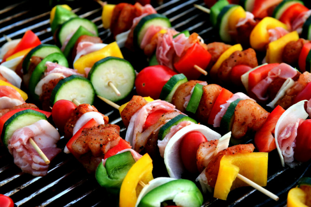 Keto While Camping kabobs on a grill