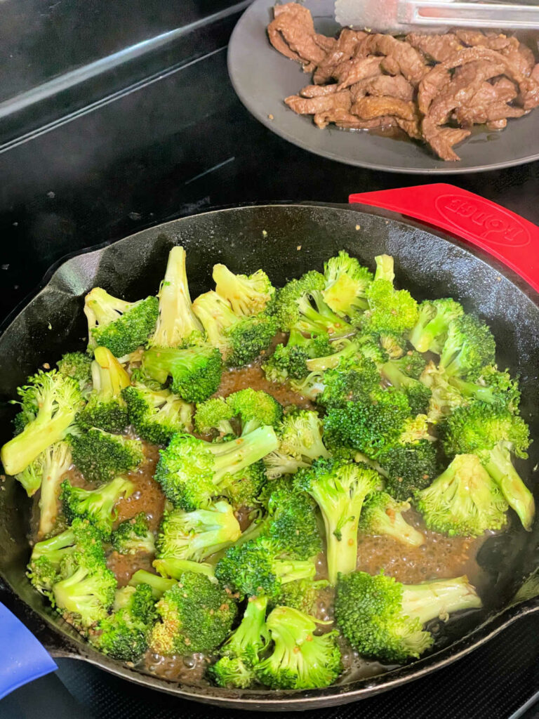 Keto Beef and Broccoli cooking in skillet