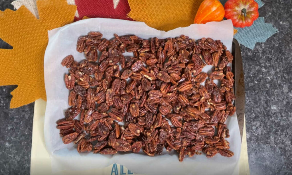 Keto Pumpkin Spiced Candied Pecans on a baking sheet
